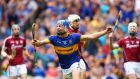 Tipperary's John McGrath celebrates scoring his  goal. Photo: Cathal Noonan/Inpho
