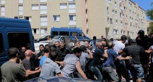 Police block  a crowd of protesters from  marching into a housing estate in the Lupino district of Bastia, which has a large North African community, on the island of Corsica on Sunday. Photograph: Pascal Pochard-Casabianca/AFP/Getty Images