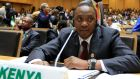 Kenya's president Uhuru Kenyatta. Charges against him of crimes against humanity were dropped at the end of 2014. Photograph: Tiksa Negeri/Reuters