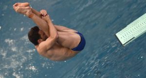 Ireland's Oliver Dingley competes in the Men's 3m Springboard Preliminary during the diving event. Photograph: Getty Images