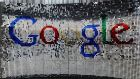 A sign featuring Google Inc.'s logo stands inside the entrance to their new UK headquarters. Photograph: Chris Ratcliffe/Bloomberg