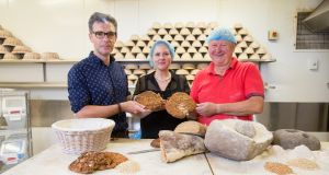 Iron Age bread with Declan Ryan, Arbutus Bread and churning of butter with Peter Foynes, director, Cork Butter Museum. Photograph Tomas Tyner/UCC.