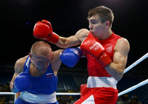 FIGHT TIME: Michael Conlan of Ireland in red and Vladimir Nikitin of Russia compete in the Men's Bantam (56kg) quarter-finals at the 2016 Rio Olympics. Conlan lost the bout, ending all of Ireland's medal chances in boxing at these Olympics. Photograph: Peter Cziborra/Reuters