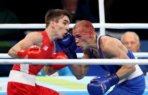 TAKING SHOTS: Michael Conlan of Ireland and Vladimir Nikitin of Russia in action. Photograph: Dan Sheridan/Inpho