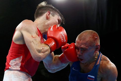 HOT LEATHER: Vladimir Nikitin takes a touch from Michael Conlan during their Bantam (56kg) quarter-finals bout. Photograph: Peter Cziborra/Reuters
