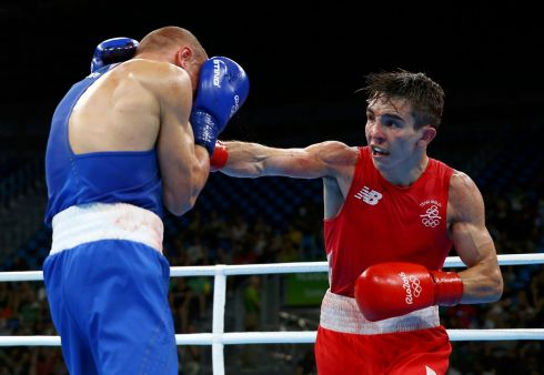 BRIEF BOUT: Michael Conlan of Ireland and Vladimir Nikitin of Russia: the brief quarter-final bout continues. Photograph: Peter Cziborra/Reuters