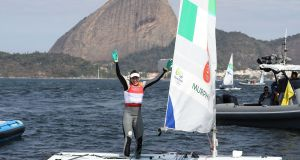 Ireland's Annalise Murphy celebrates her silver medal in the women's Laser Radial Medal race. Photograph:  Martin Rickett/PA Wire