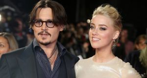 Johnny Depp and Amber Heard have settled their contentious divorce and the actress has withdrawn her allegations that the actor had been physically abusive towards her. File photograph: Joel Ryan/AP