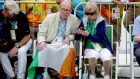 Minister for Sport  Shane Ross and his wife Ruth Buchanan at Annalise Murphy's medal ceremony  in Rio. Photograph: Morgan Treacy/Inpho