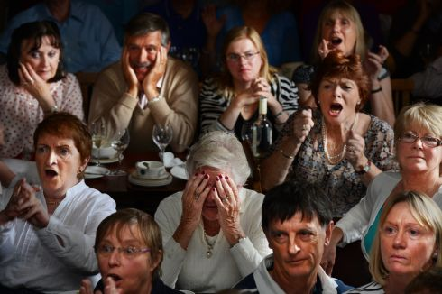 Members of the National Yacht Club in Dun Laoghaire react as  Annalise Murphy missed out on a medal during the Olympic final medal race at the London 2012 Olympics. Photograph: Cyril Byrne / The Irish Times
