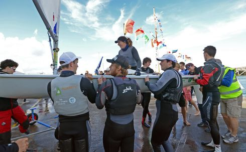 Ireland's Annalise Murphy carried ashore by supporters after winning the Laser European Championships, at Dun Laoghaire in 2013.   Photograph: Eric Luke / The Irish Times