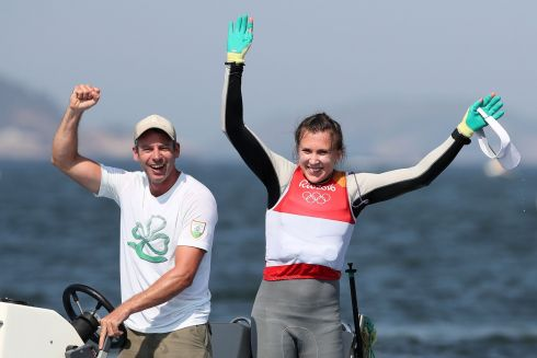 Ireland's Annalise Murphy celebrates her silver medal in the women's Laser Radial Medal race with her coach Rory Fitzpatrick on the eleventh day of the Rio Olympic Games, Brazil. Photograph: Martin Rickett/PA