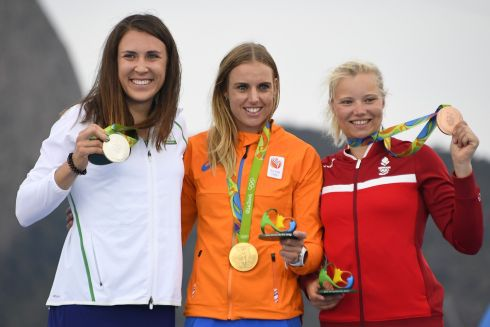 Netherlands' gold medallist Marit Bouwmeester (C), Ireland's silver medallist Annalise Murphy (L) and Denmark's bronze medallist Anne-Marie Rindom (L) pose on the podium of the Laser Radial Women medal race at Marina da Gloria during the Rio 2016 Olympic Games in Rio de Janeiro on August 16th. Photograph:  Damien Meyer /AFP