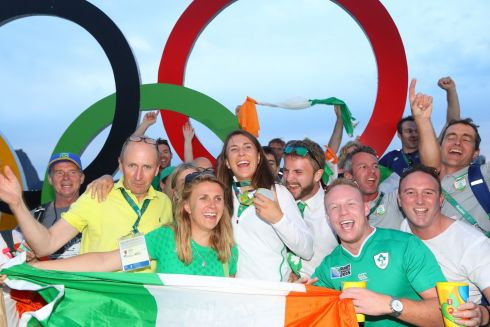 Ireland's Annalise Murphy celebrates with her family, including father Con (yellow top) at her medal ceremony.  Photograph: Morgan Treacy / INPHO