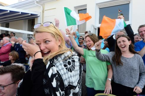 Club members and fans watch  Annalise Murphy winning silver at her home club,  the National Yacht Club in Dun Laoghaire.   Photograph: Cyril Byrne / The Irish Times
