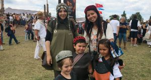 Reihan (left) and Fazana, ethnic Uzbeks from Germany, with their children at Hungary's Kurultaj festival of ancient Turkic cultures and traditions. Photograph: Daniel McLaughlin