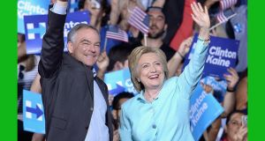 US Democratic vice presidential candidate senator Tim Kaine with US Democratic presidential candidate  Hillary Clinton. Photograph:  Gustavo Caballero/Getty Images