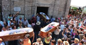 Pallbearers bring out the coffins from the church in Las Nieves in Galicia during the Fiesta de Santa Marta de Ribarteme – the 'corpses' have had near-death experiences, and want to give thanks to the saint for sparing their lives. photograph: stuart abraham