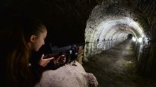 A visitor investigates what it would have been like to aim a Thompson submachine gun down the long tunnel at the grounds of the Casino at Marino in Dublin, where the weapons were test-fired during the War of Independence.  Photograph: Alan Betson/The Irish Times