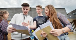 Ian Bethel, Ian McCrae and Fionnuala Moran, former 6th year students of Mount Temple Comprehensive school, Clontarf, after receiving their Leaving Certificate results. Photograph: Alan Betson/The Irish Times