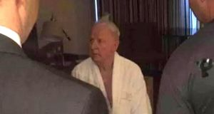 Dressing gown: from a video of Pat Hickey with Rio police in his hotel room