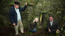 Clones historian George Knight,  Monaghan county heritage officer Shirley Clerkin and Pat Treanor of  Fáilte, inspect the recently uncovered ruins of the Clones plantation castle that will be on public view for the first time during National Heritage Week. Photograph:  Philip Fitzpatrick