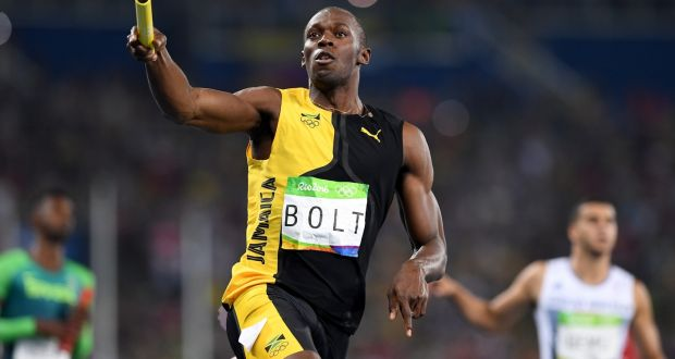 Usain Bolt Of Jamaica Crosses The Finishline To Win Mens 4x100m Relay Photograph