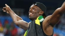 Kingston erupts as Usain Bolt signs off with 'triple-triple'