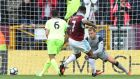 Burnley's Andre Gray scores his team's second goal. Photograph: Scott Heppell/Reuters