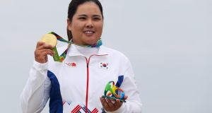 South Korea's  Inbee Park  shows off her gold medal after winning the women's golf tournament  at the Olympic Golf Course  in Rio. Photograph: Scott Halleran/Getty Images