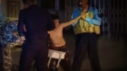 Iraqi police detain boy after removing suicide belt from him