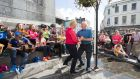 Mike Mahony and Marion Casey make the most of the sunshine between the showers on O'Connell Square in Ennis at the Fleadh. Photograph: Eamon Ward