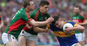 Mayo's Colm Boyle and Lee Keegan tackle Tipperary's Michael Quinlivan. There is a price to pay for taking all those tackles. Every heavy hit softens you up to some extent. Photograph: Lorraine O'Sullivan/Inpho