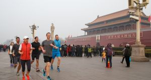 "Facebook founder Mark Zuckerberg running in Tiananmen Square in ""hazardous"" air conditions in March. Photograph: AFP/Getty Images"