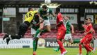 Mark O'Sullivan challenges for the ball during Cork City's friendly draw with Oman. Photograph: Inpho
