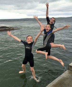"""My children Aisling, Sarah and Claire Carroll pier jumping in the late evening high tide at Rosses Point, Co Sligo."" Photograph: Johanna Moore"