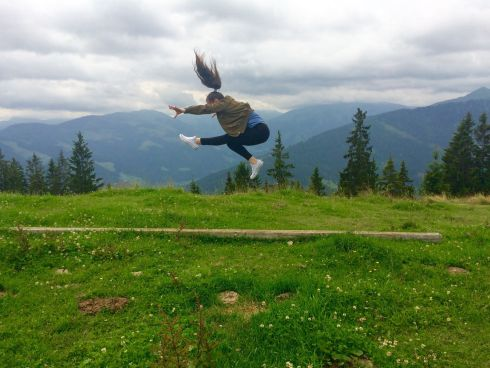 """My daughter doing a wolf jump at the top of a mountain in Niedarau, Austria."" Photograph: Rachel Jevens"