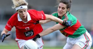 Mayo's Martha Carter, who played a Connacht final with a broken hand, tackles Cork's Valerie Mulcahy. Photograph: Ryan Byrne/Inpho