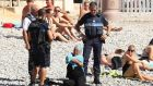 "'Police in Nice forced a woman on the beach to remove items of clothing that they deemed were not in line with ""good morals and secularism"".' Photograph: Vantage News"