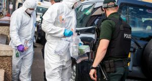 PSNI officers remove items following searches  in Larne, Co Antrim, yesterday, after the arrest of a Royal Marine for questioning in connection with  two major dissident republican arms finds. Photgraph: Liam McBurney/PA Wire