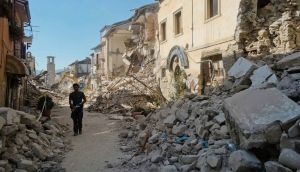 A man walks in a street in Amatrice, central Italy, where a 6.1 earthquake struck just after 3:30 am on Wednesday. Photograph: Emilio Fraile/AP