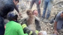 Girl buried for 15 hours pulled from rubble of Italy earthquake