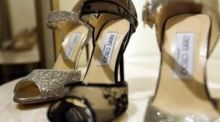 Jimmy Choo added 5.3% after the luxury shoemaker  posted higher first-half revenue and earnings