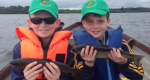 Davin Reynolds (10), left, and Conor Tynan (9) during the youth trout competition on Lough Sheelin.