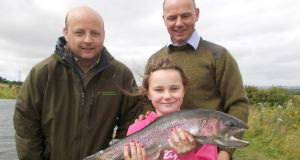 Alana Kerr (9). Co Meath, and Brendan Kerr, Oisin Cahill, IFI, at Courtlough Fishery.