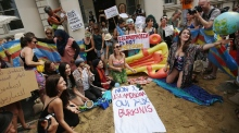 Burkini ban protesters host beach party outside French embassy in London