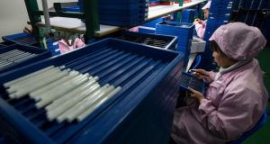 Employees check electronic cigarettes at a production line in a factory in Shenzhen, southern Chinese province of Guangdong. Photograph: Tyrone Siu/Reuters