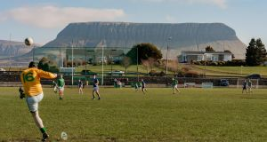 "Grange, Co Sligo: The mountain overlooking the home of the Naomh Molaise club here is Ben Bulben which, according to locals, is only clearly visible in the early months of the year. The photo was taken from the goalmouth itself in the dying seconds of the match after Carroll ""chanced his arm"" and stepped in."