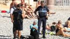 Police order a Muslim woman to remove her burkini on a beach in Nice this week. Photograph: Poppy Gold