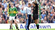 Dublin manager Tommy Carr argues with referee Mick Curley during the 2001 All-Ireland quarter-final against Kerry in Thurles.  Photograph: Billy Stickland/Inpho